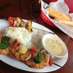 Photo taken at Bubba Gump Shrimp Co. by Fawaz A. on 6/12/2013