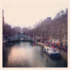 Photo taken at Canal Saint-Martin by Erwan L. on 12/8/2012