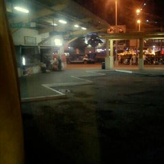 Photo taken at Marquee Mall Bus Station by Lady P. on 11/23/2012