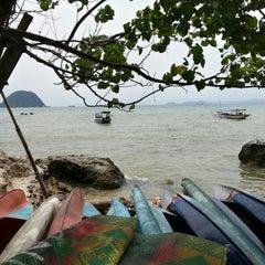 Photo taken at Pantai Pasir Putih by Anton R. on 11/14/2014