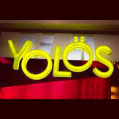 Photo taken at Yolös Mexican Grill by AK O. on 10/7/2012