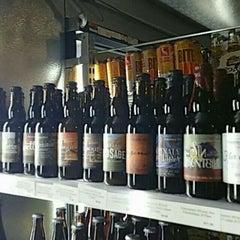 Photo taken at Mile High Wine & Spirits by Jesse P. on 7/19/2015