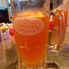 Photo taken at Pluckers Wing Bar by Chris F. on 4/2/2015