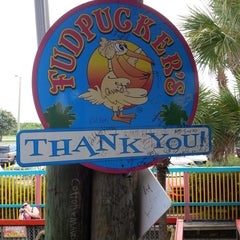 Photo taken at Fudpuckers Beachside Bar & Grill by Scott W. on 7/15/2013