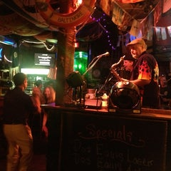 Photo taken at Cat's Eye Pub by Ben C. on 8/8/2013