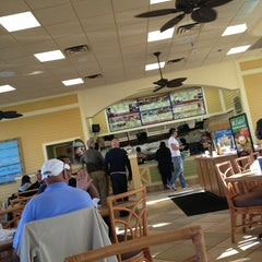 Photo taken at Pollo Tropical by Brittley O. on 3/3/2013
