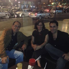 Photo taken at News Cafe by Giuliano A. on 10/12/2014