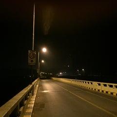 Photo taken at Mandovi Bridge by Aditya D. on 2/14/2015