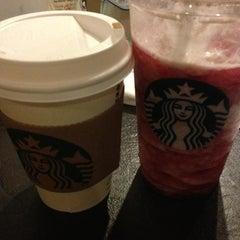 Photo taken at Starbucks by Ece P. on 2/5/2013