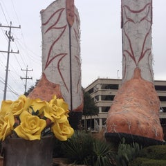 Photo taken at World's Largest Cowboy Boots by Howard H. on 1/25/2014