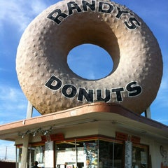 Photo taken at Randy's Donuts by Meg J. on 12/21/2012