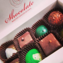 Photo taken at Shocolate Master Chocolatiers by Vicky E. on 3/19/2014
