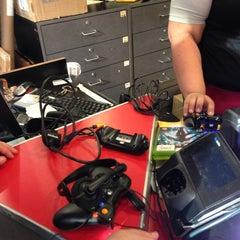 Photo taken at GameStop by Laura N. on 7/2/2013
