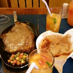 Photo taken at Mooon Cafe by Aura S. on 8/30/2015