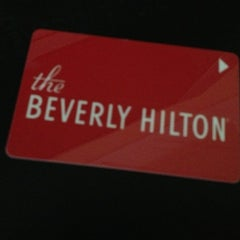Photo taken at The Beverly Hilton by Ian W. on 3/7/2013