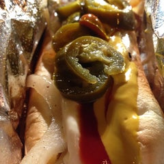 Photo taken at Bacon-Wrapped Hot Dog Cart by Norris T. on 7/27/2013