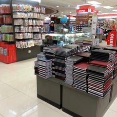 Photo taken at POPULAR Bookstore by Sofhieeya K. on 12/8/2012