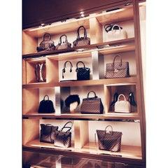 Photo taken at Louis Vuitton by Melissa F. on 11/29/2014