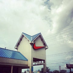 Photo taken at Nike Outlet Store by J V. on 9/1/2013