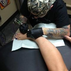 Photo taken at Carmel Tattoo INK by Rachel R. on 10/5/2013