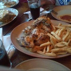 Photo taken at Nando's by Sara F. on 12/24/2012