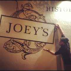 Photo taken at Joey's by Julian V. on 12/8/2012