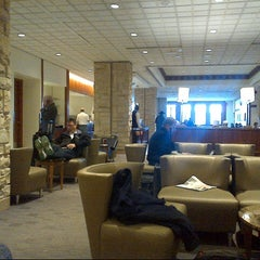 Photo taken at Delta Sky Club by Russell F. on 3/19/2013