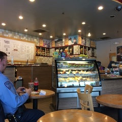 Photo taken at Organic Coffee Co. by Paula M. on 6/2/2014