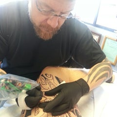 Photo taken at Guru Tattoo by Terry S. on 3/11/2014