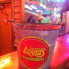 Photo taken at Logan's Roadhouse by Rhett B. on 3/23/2013