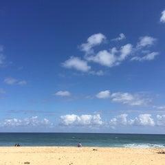 Photo taken at Ehukai Beach by Jocelyn C. on 5/25/2015