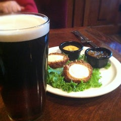 Photo taken at The Lion & Rose British Restaurant & Pub by Mike L. on 9/16/2012