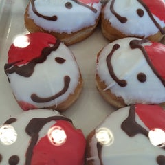 Photo taken at Krispy Kreme Doughnuts by Asako V. on 9/13/2014