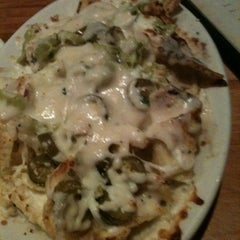 Photo taken at Carino's Italian Grill by Brandon R. on 3/18/2011