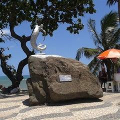 Photo taken at Praia de Itapuã by Cristiane R. on 2/9/2013