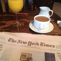 Photo taken at Cosmopolitan Cafe by Nigel H. on 12/8/2013