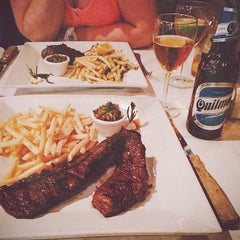 Photo taken at New Campo Argentino SteakHouse by Martijn K. on 5/14/2014