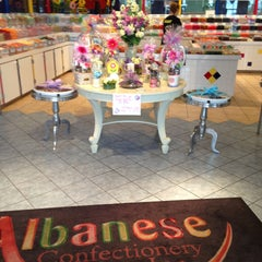 Photo taken at Albanese Confectionery by Renée J. on 4/19/2013