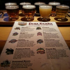Photo taken at Four Peaks Grill & Tap by Marc A. on 12/23/2012