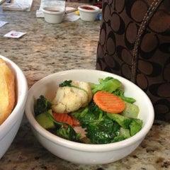 Photo taken at Facundo Cafe by Tekoah J. on 12/7/2012