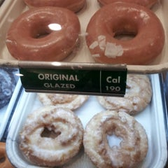 Photo taken at Krispy Kreme Doughnuts by Kim C. on 12/30/2012