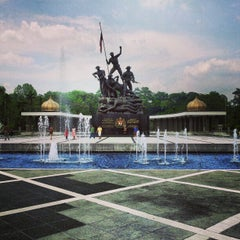 Photo taken at National Monument (Tugu Negara) by Victor Q. on 3/26/2013