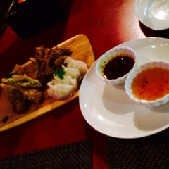 Photo taken at Coconut Thai Cuisine & Asian Fusion Restaurant by Madison B. on 3/15/2014