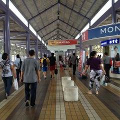 Photo taken at Yishun Temporary Bus Interchange by Jon A. on 1/24/2013