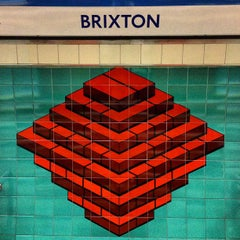 Photo taken at Brixton London Underground Station by carcher 8. on 5/7/2013
