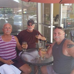 Photo taken at Bongo Johnny's Patio Bar and Grille by Chip W. on 6/21/2014