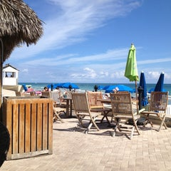 Photo taken at Bamboo Beach Tiki Bar & Cafe by Robert H. on 2/21/2013