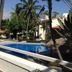 Photo taken at Villas del palmar by Manijeh L. on 3/16/2013