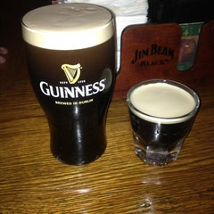 Photo taken at Sláinte Irish Pub by Patrick on 1/27/2013