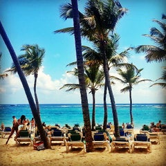 Photo taken at Riu Palace's Beach by Marcelo E. on 5/17/2013